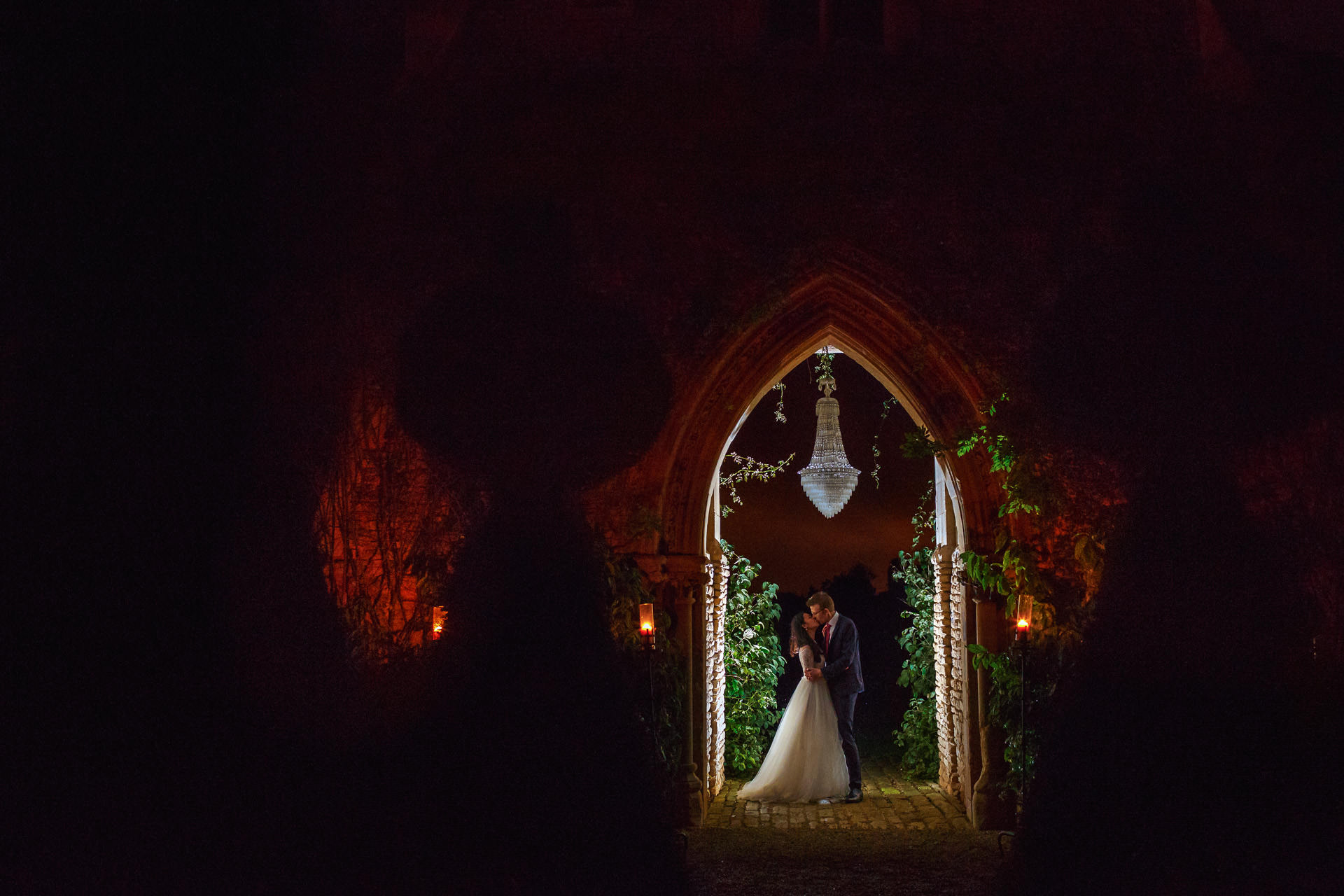 wedding photo under the arch of a married couple