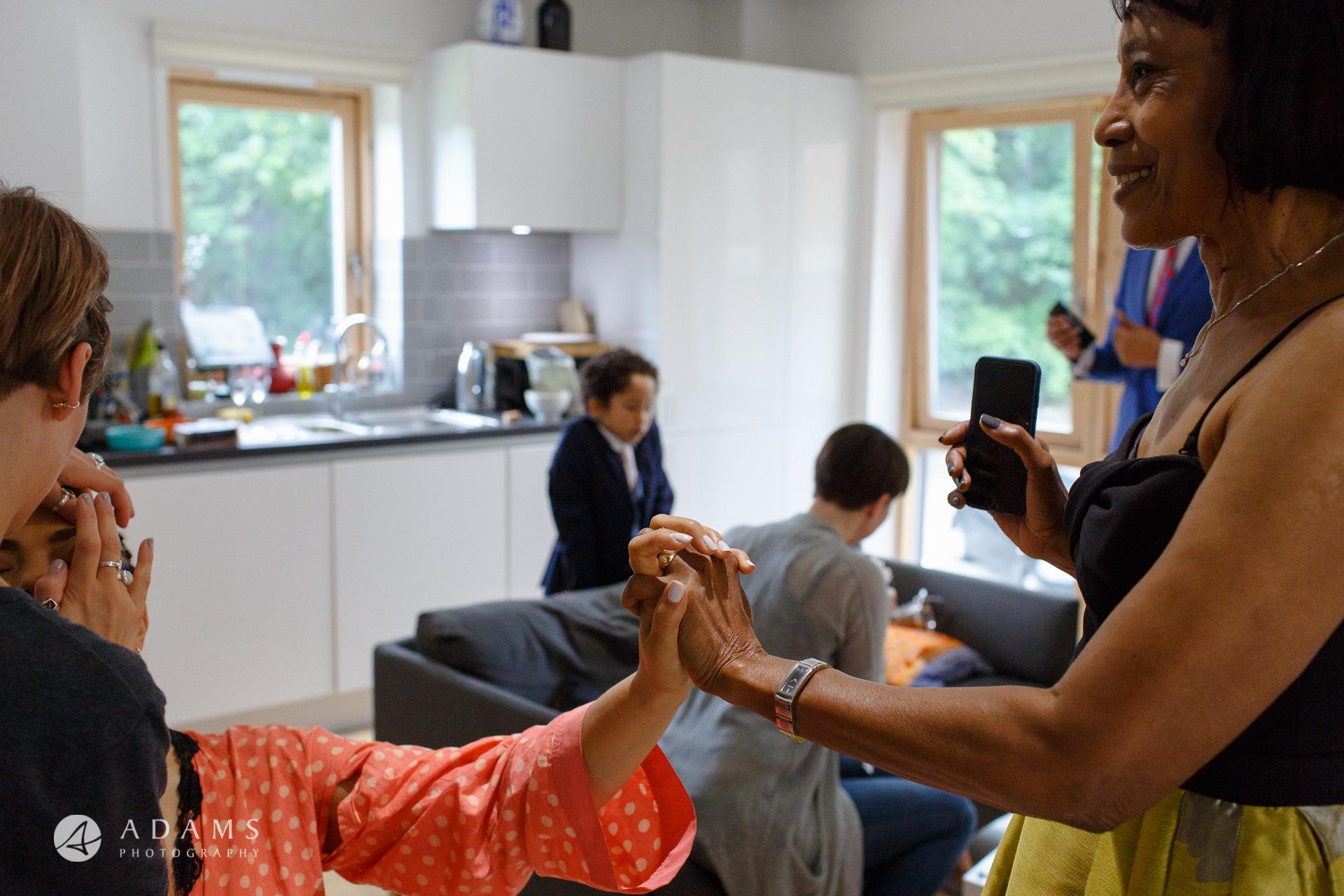 Morden Hall Wedding photos high five with brides mother