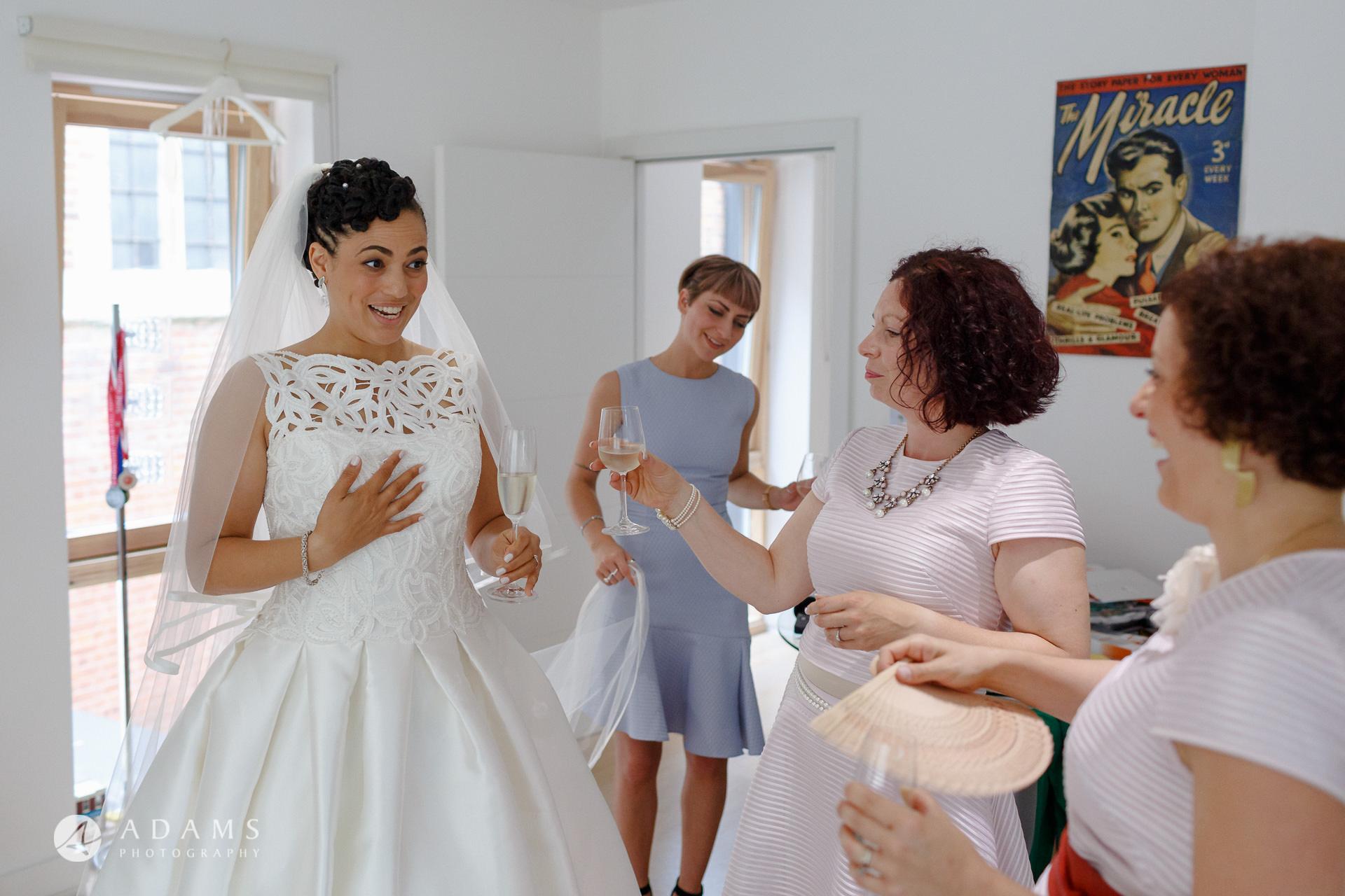 Morden Hall Wedding bride and her bridesmaid chatting