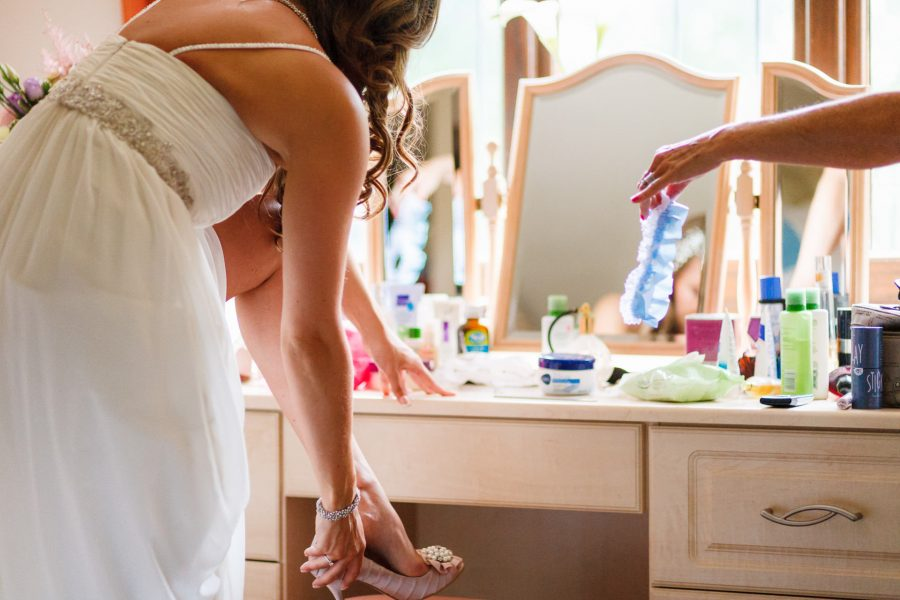 London Wedding Photography Portfolio bride putting on a garter