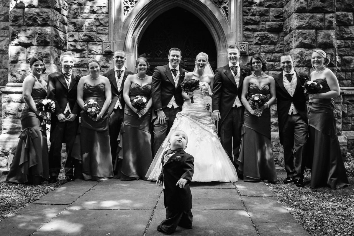 London Wedding Photography Portfolio group photo with a kid in front