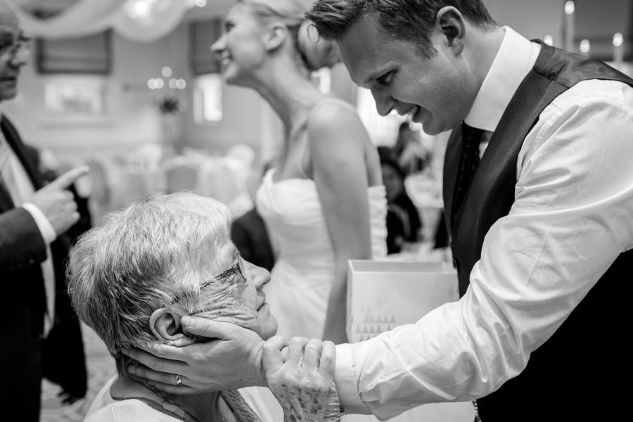 London Wedding Photography Portfolio groom having an emotional moment with his grandmother