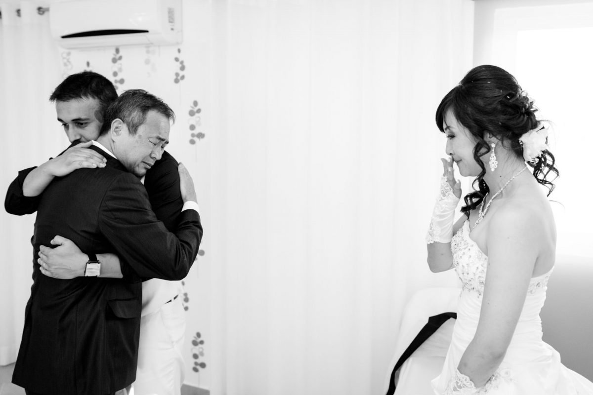 London Wedding Photography Portfolio bride crying while groom hugs her father