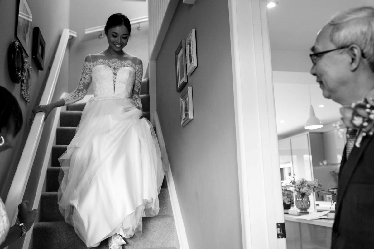 London Wedding Photography Portfolio bride walks down the stairs
