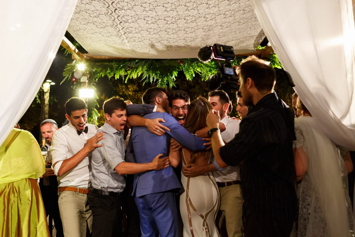 Jewish Couple Guests Celebrating Marriage Under Chuppah