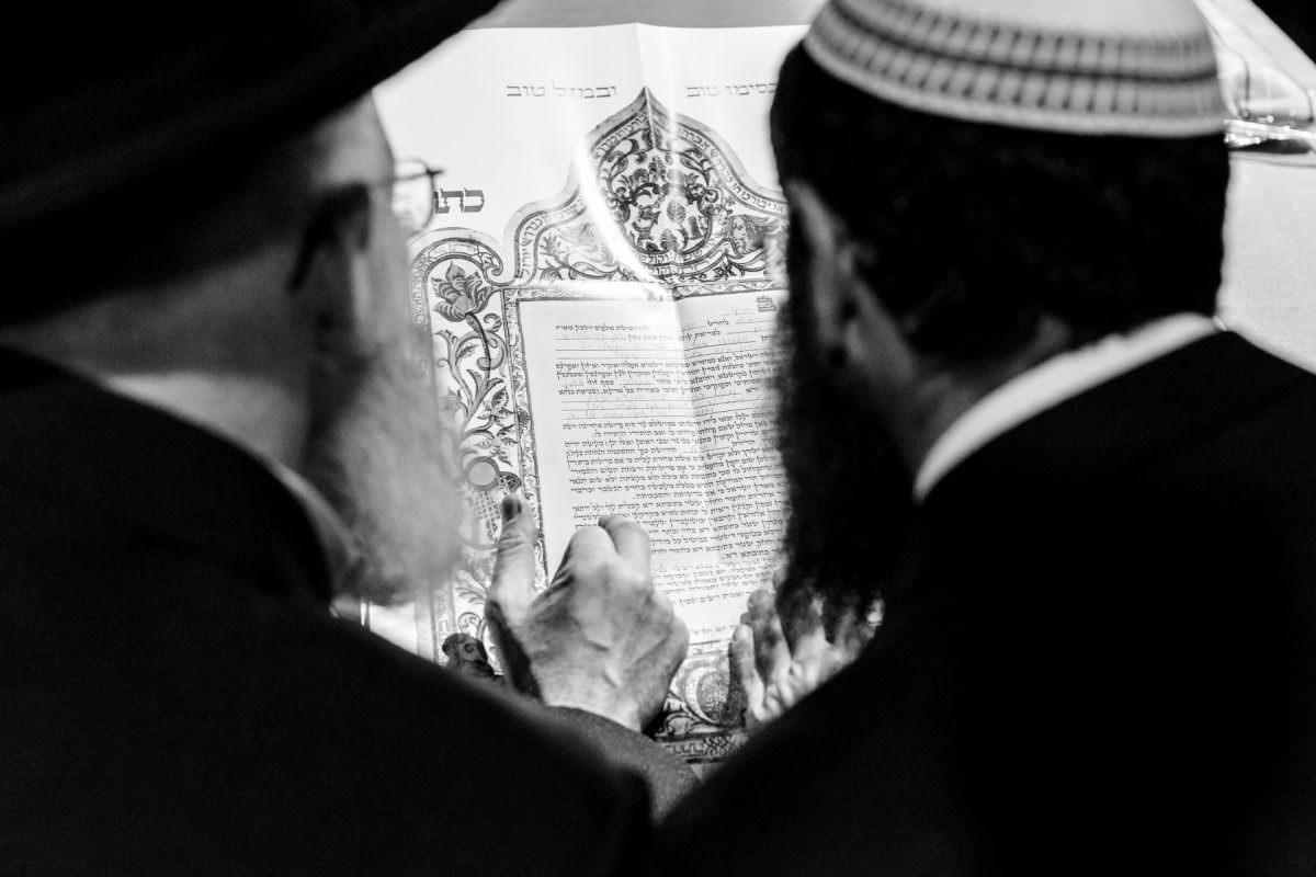 Jewish Rabin Reading Ketubah Before Jewish Wedding Ceremony