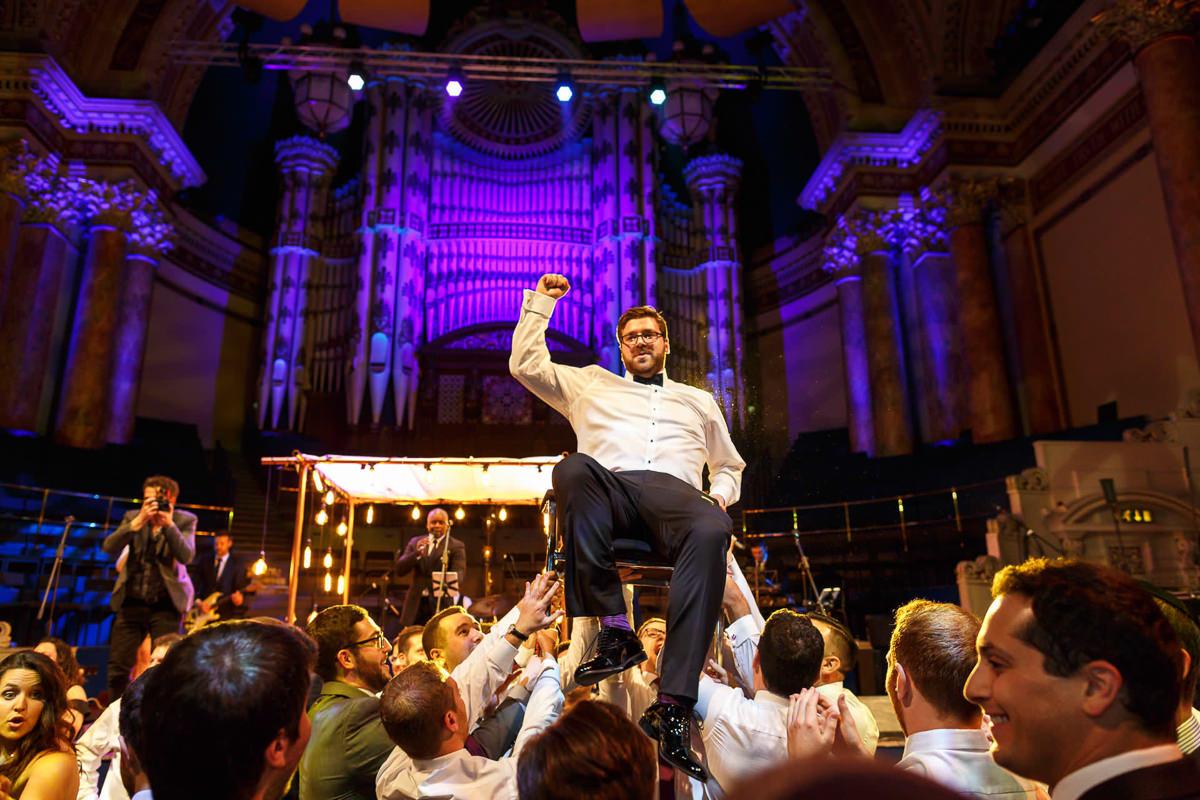 Jewish Wedding Photographer chair dance during Israeli dancing