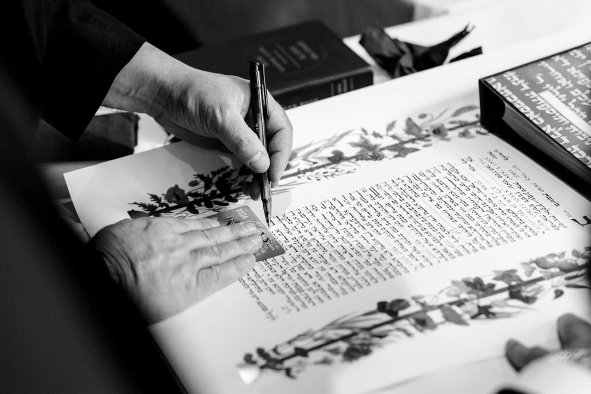 Jewish Wedding Photography signing Ketubah in UK