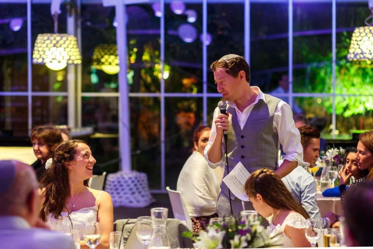 Jewish Wedding Photography Speeches Bride Looks at Groom