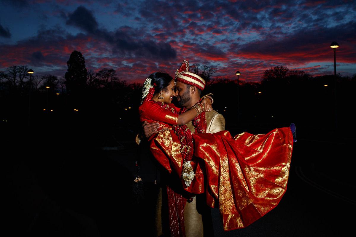 Tamil Groom Holding Bride