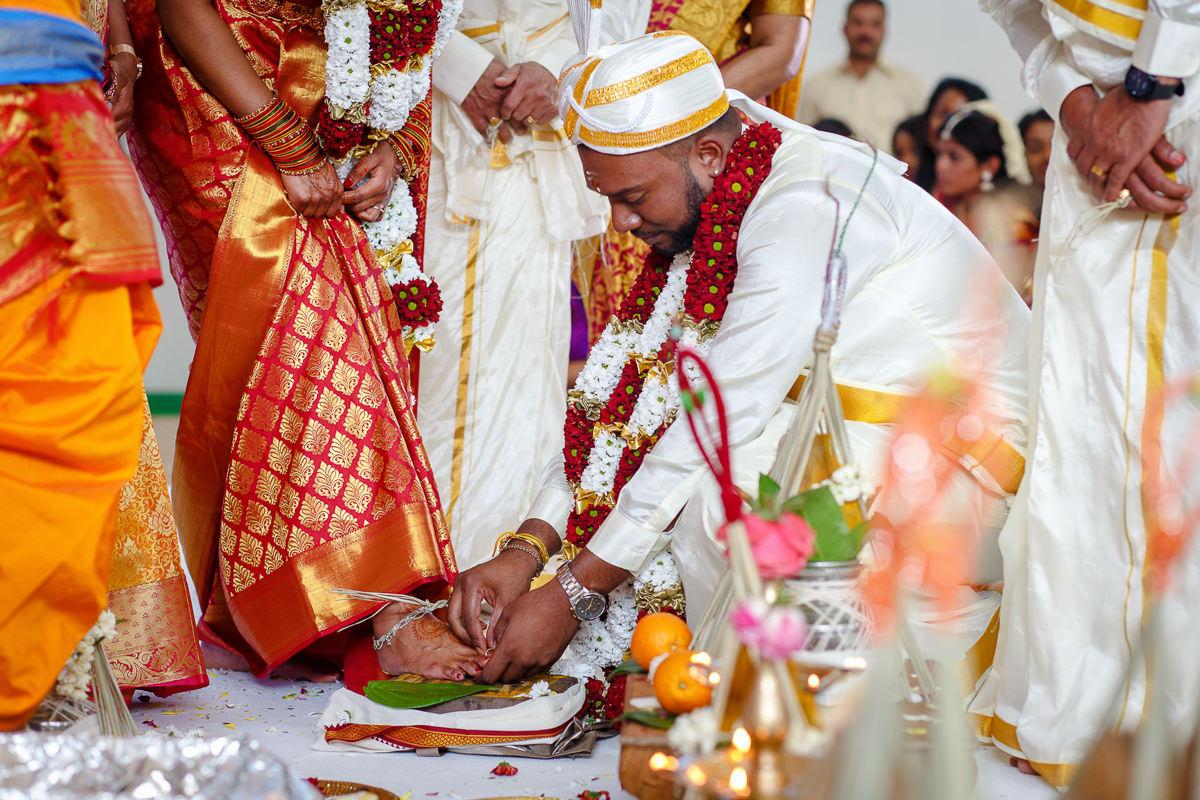 Tamil Groom Putting Ring On Bride Toe