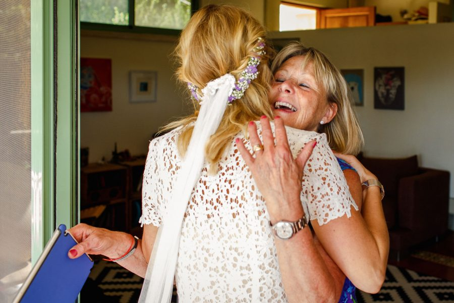 destination wedding photographer mother hugs the bride