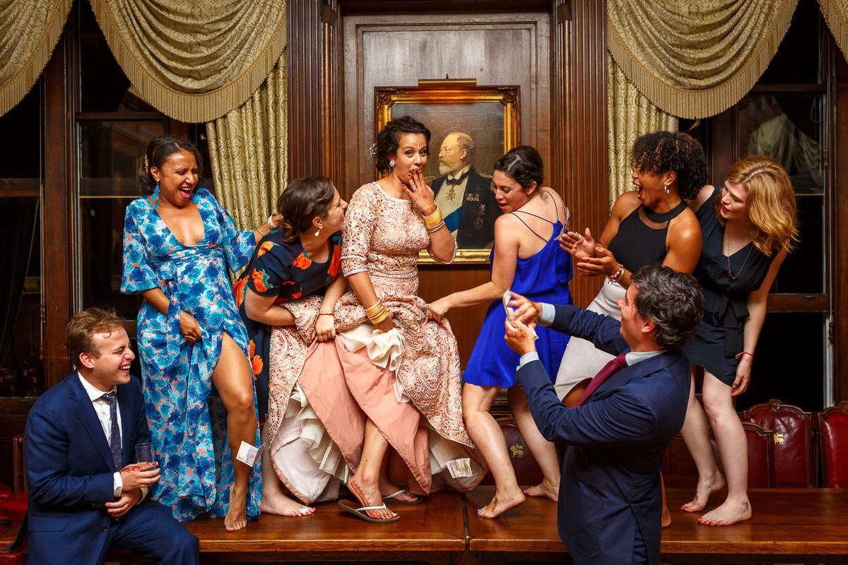 Bride Bridesmaids Dancing On Table At Wedding London