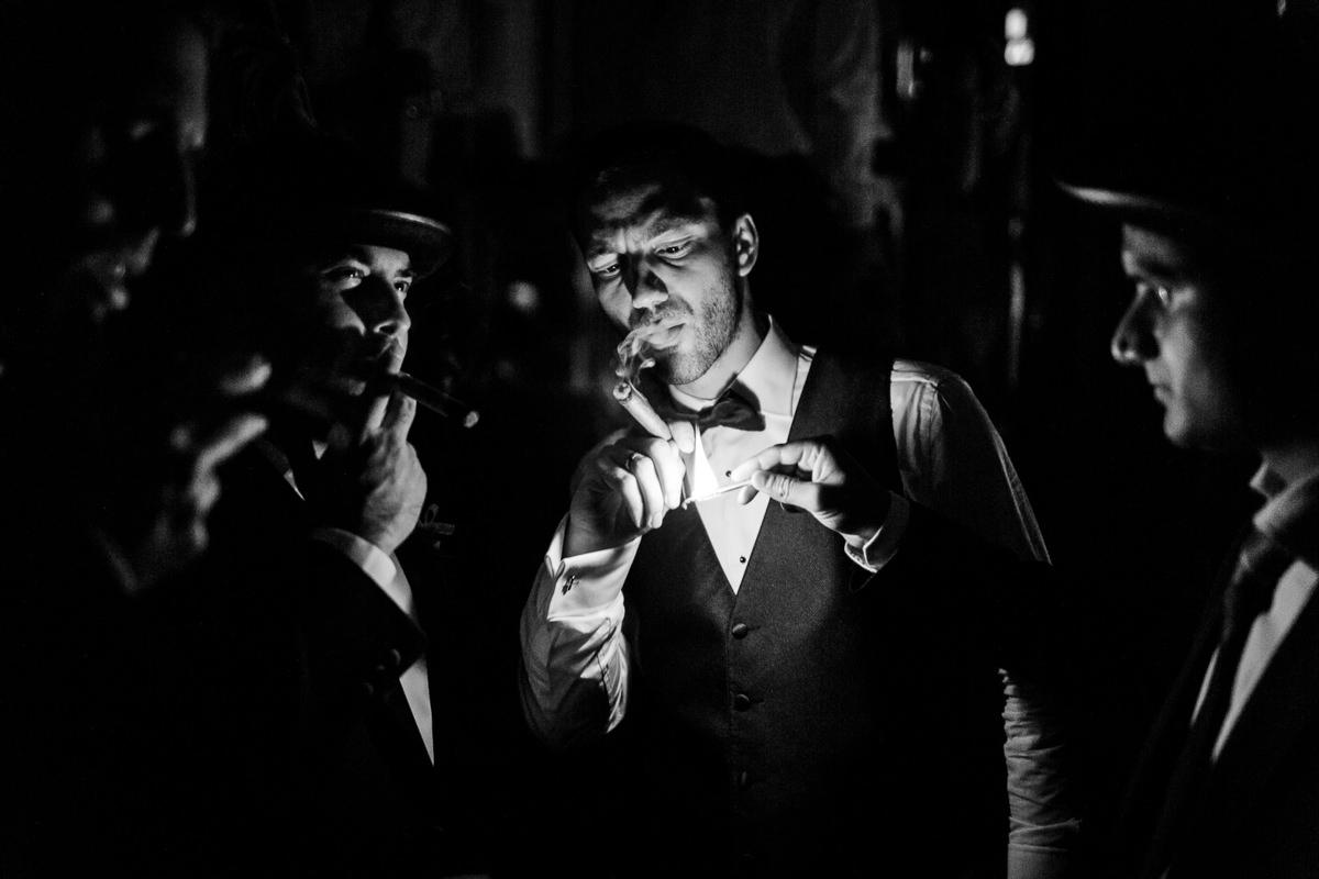 Grooms Smokes Cigar At Wedding