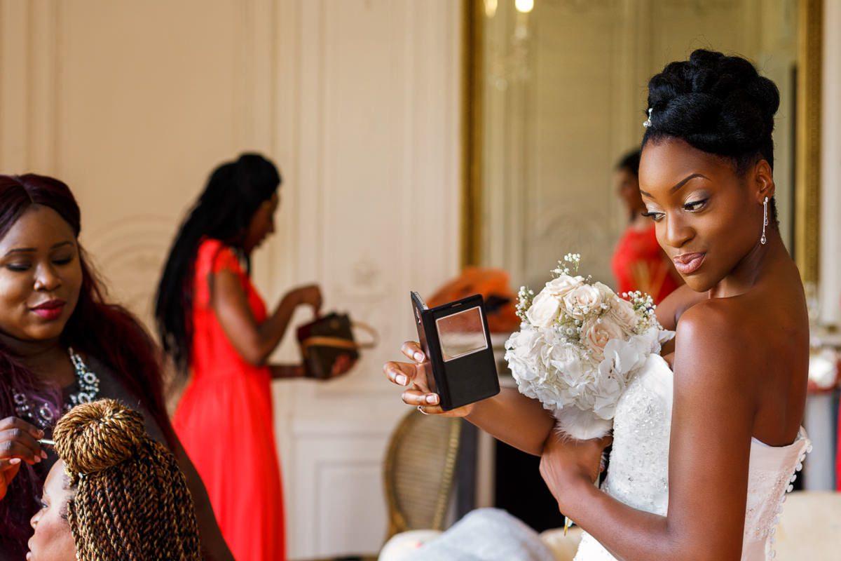 Best wedding photographer bride looking in the mirror