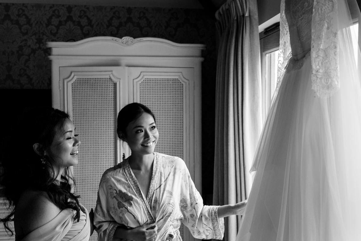 Best wedding photographer UK bride checking her dress