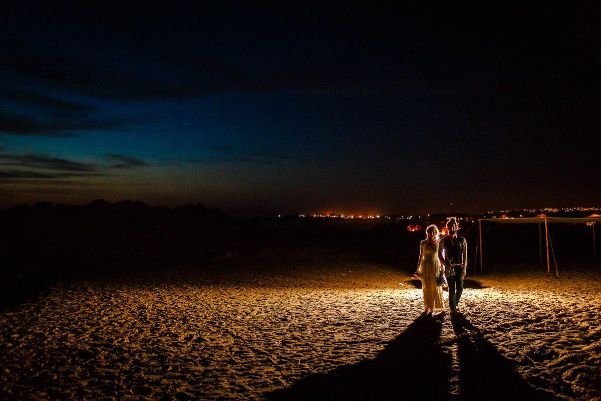 Best wedding photographer UK night shot of the couple walking