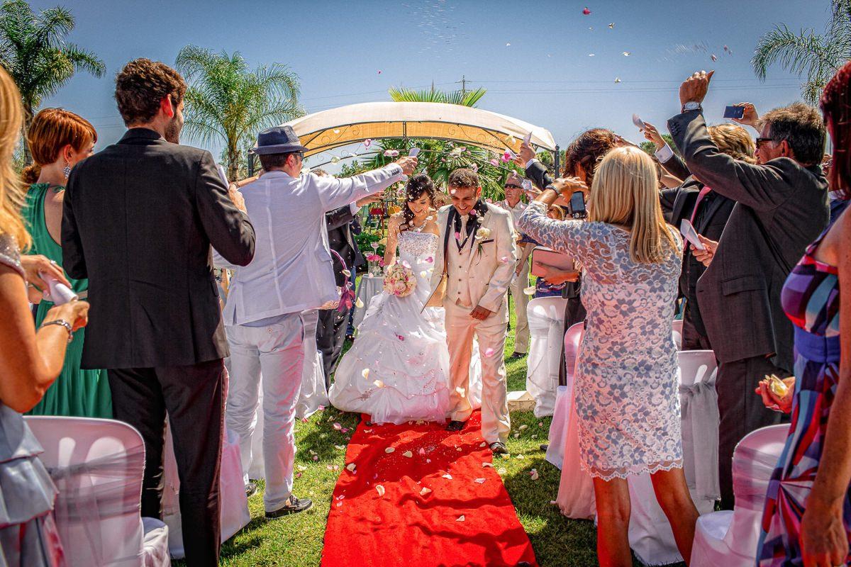 Best wedding photographer London UK couple under confetti shower