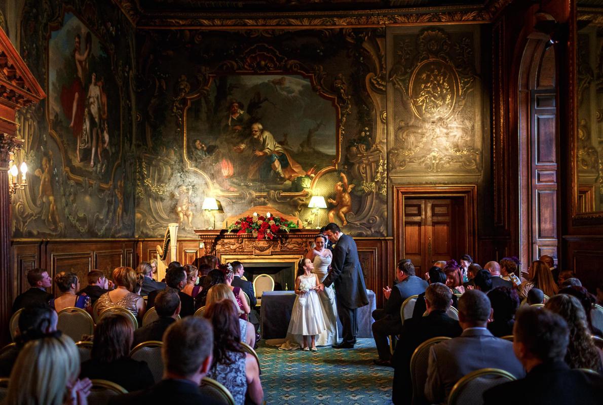 Best wedding photographer UK married couple talk to a little girls