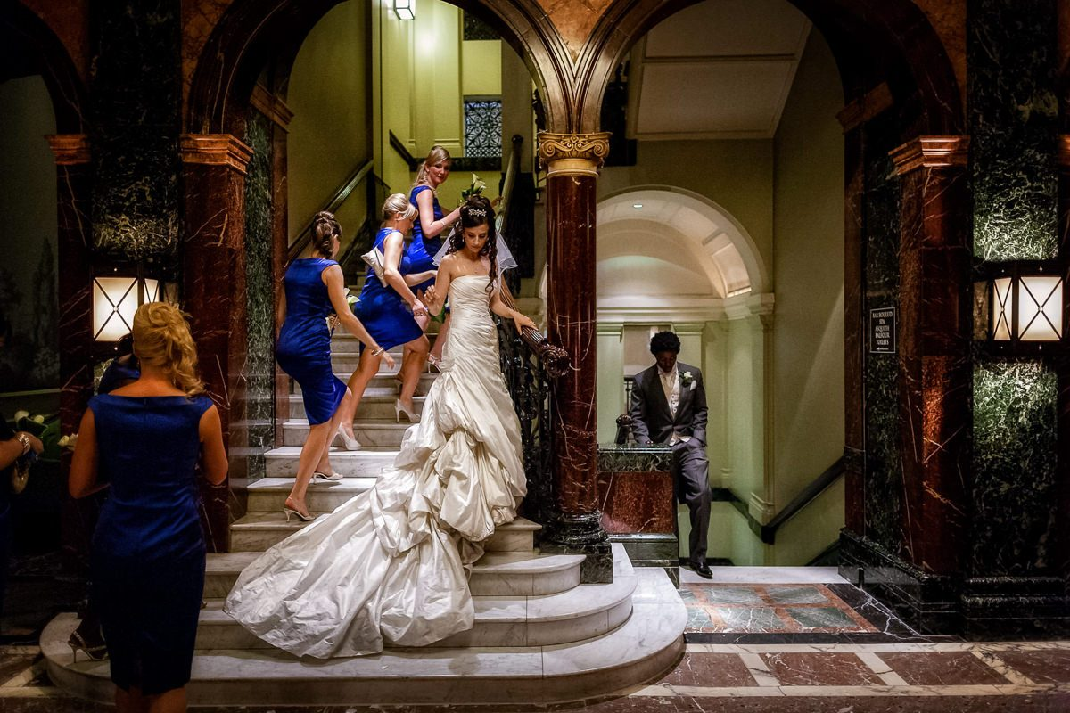 Best wedding photographer UK bride on the stairs