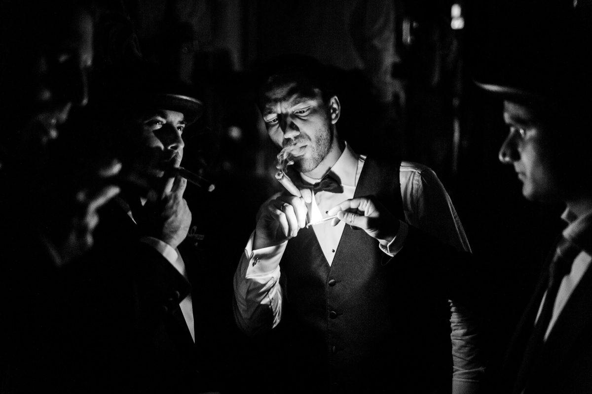 Best wedding photographer groom smoking cigar