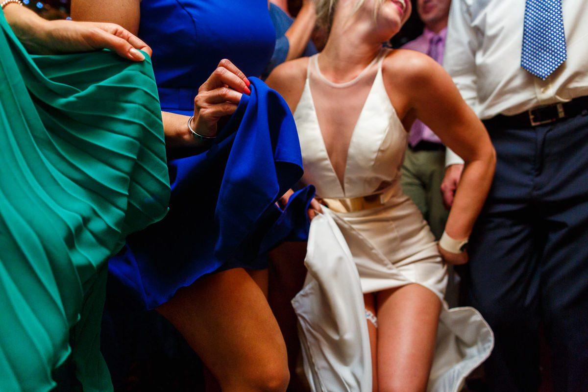 Best wedding photographer crazy dance showing legs
