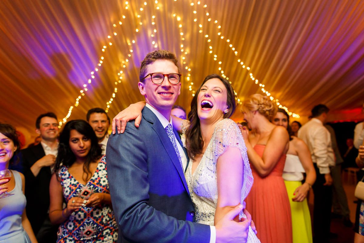 Best wedding photographer UK bride and groom laugh during the party