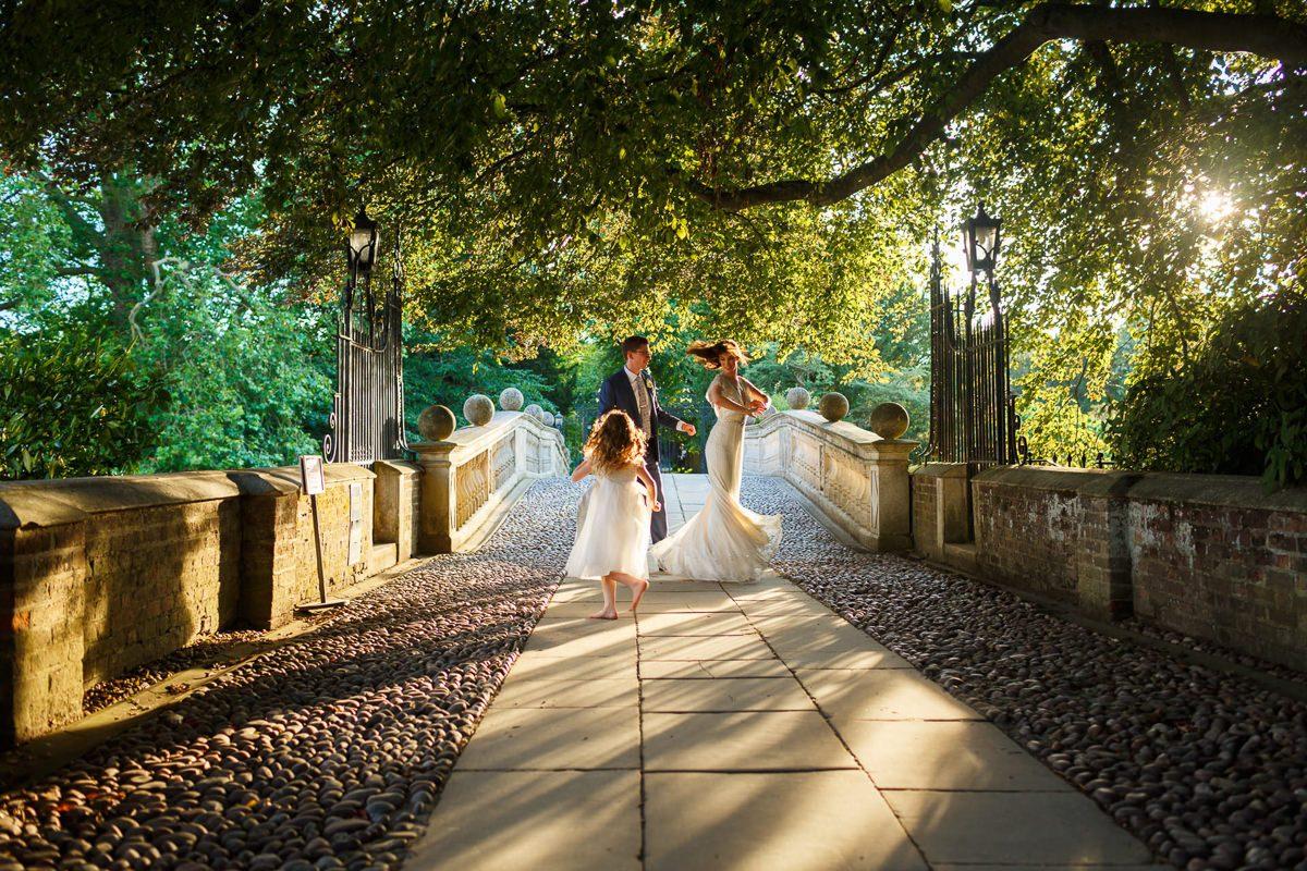 Best wedding photographer couple dancing on the bridge