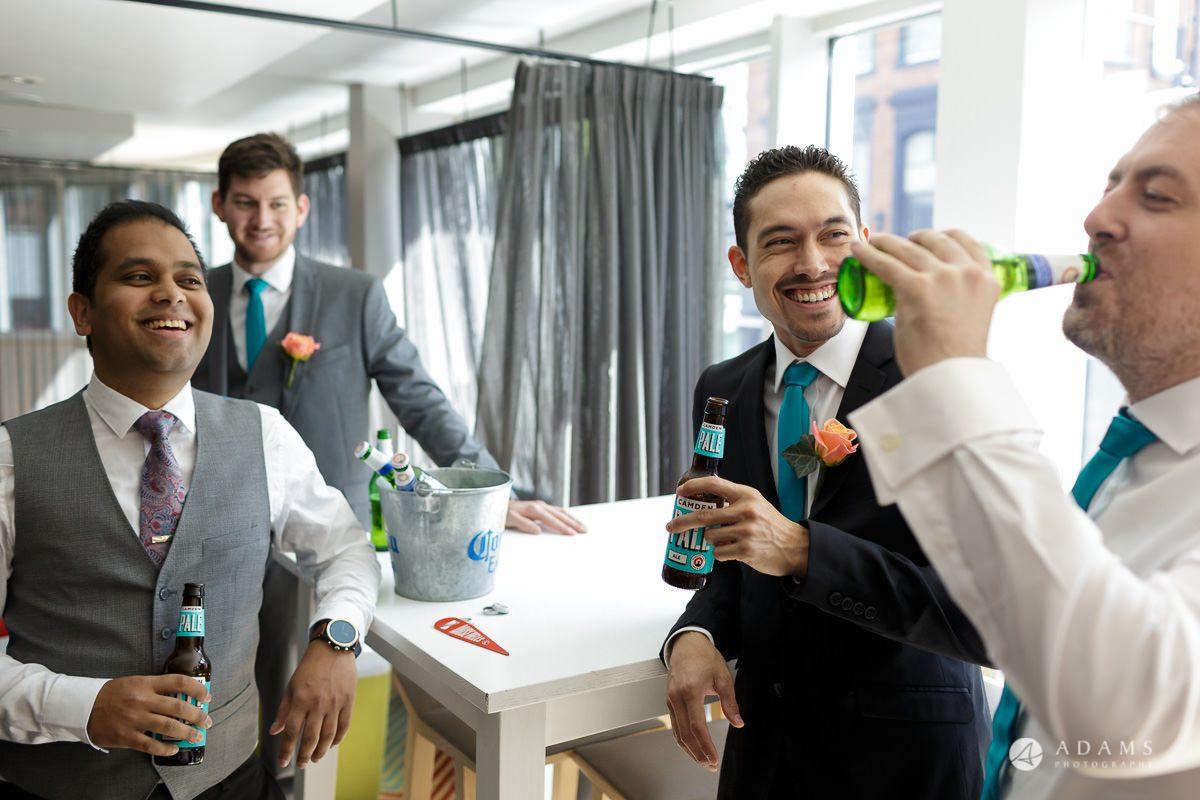 Camden Town wedding groomsmen drinking beer