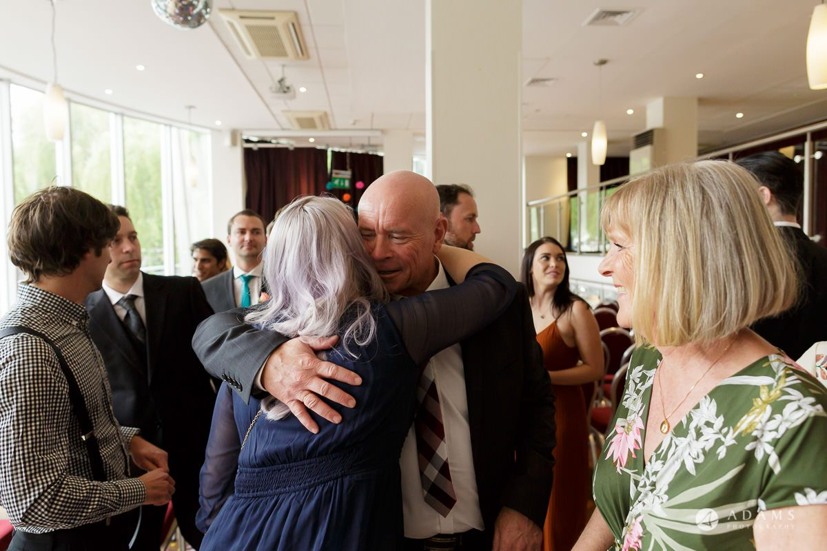 Camden Town wedding parents hug