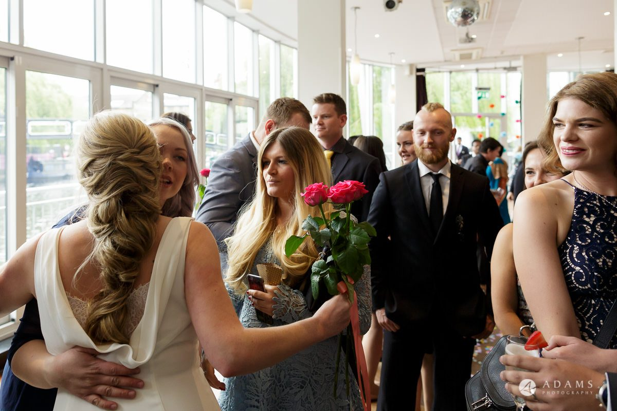 Camden Town wedding guests hug
