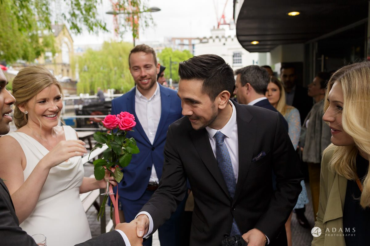 Camden Town wedding guests having a rose in hand