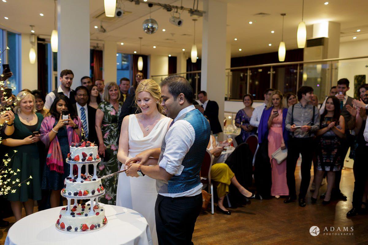 Camden Town wedding catting the cake