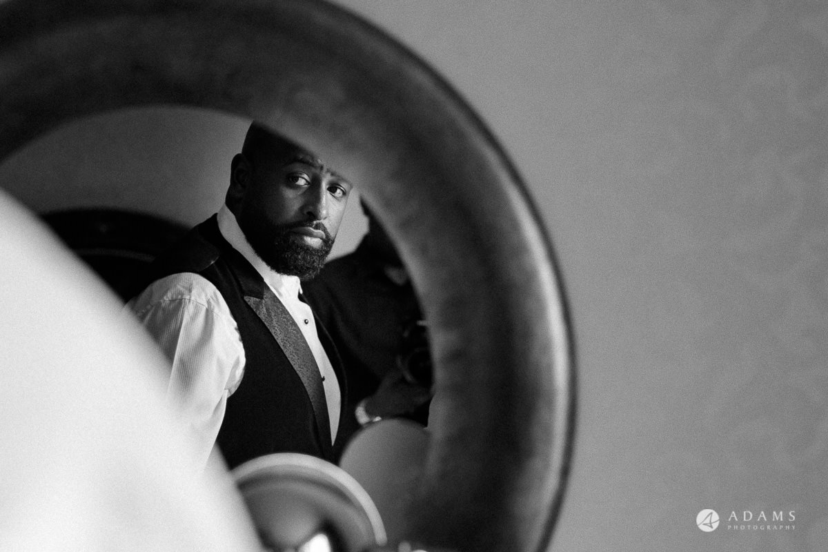 syon park house wedding groom looking in the mirror Photography