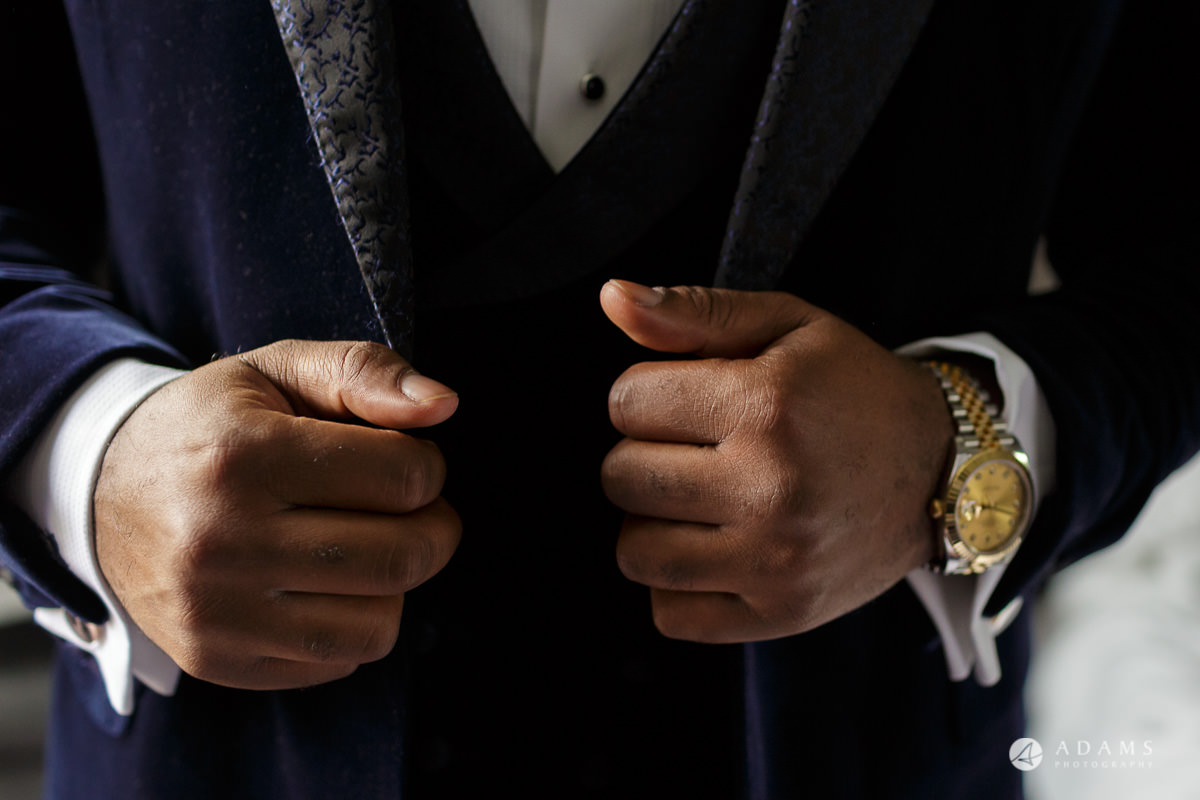 syon park house wedding groom is ready and show his watch