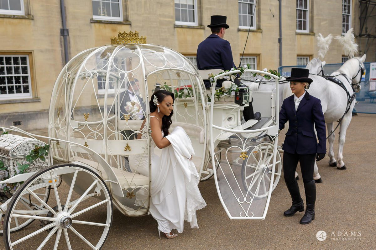 syon park house wedding bride gets of the car