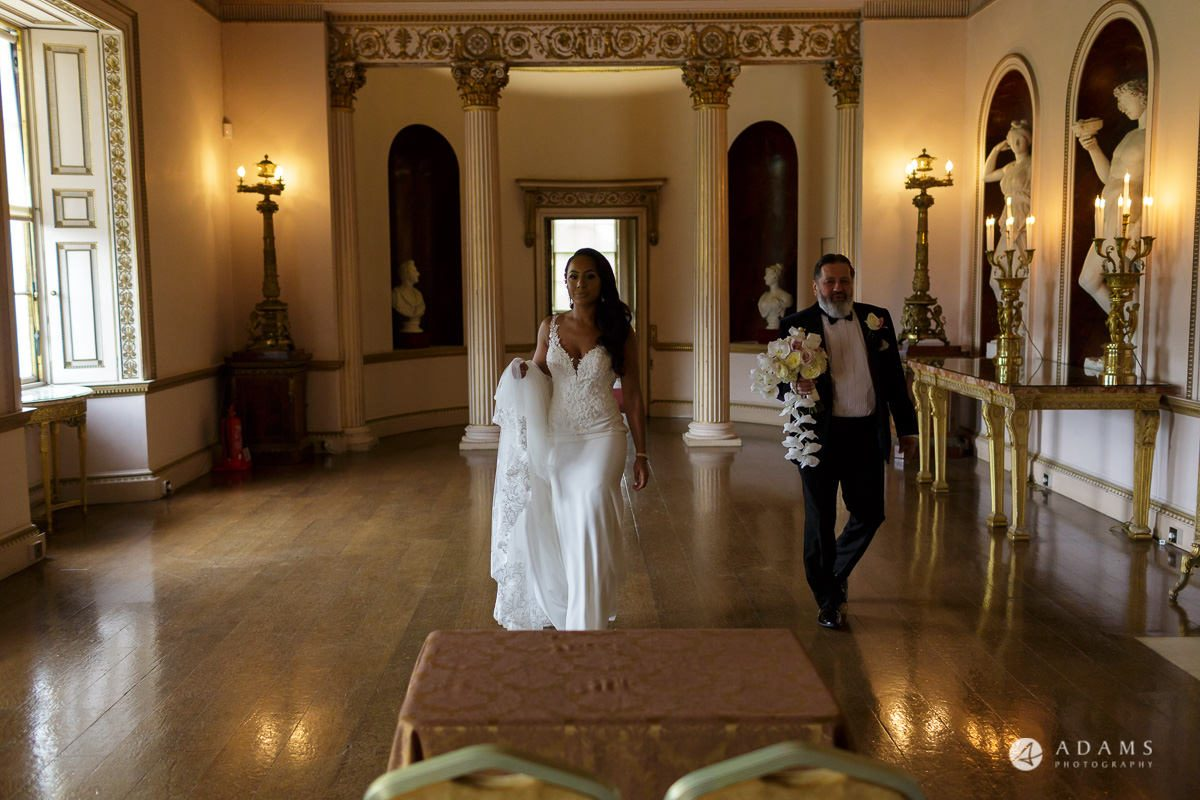 syon park house wedding bride walks with her father