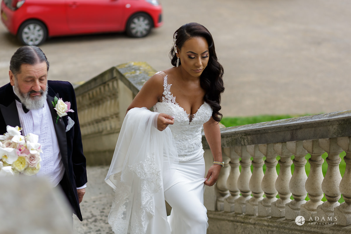 syon park house wedding bride walks up the stairs