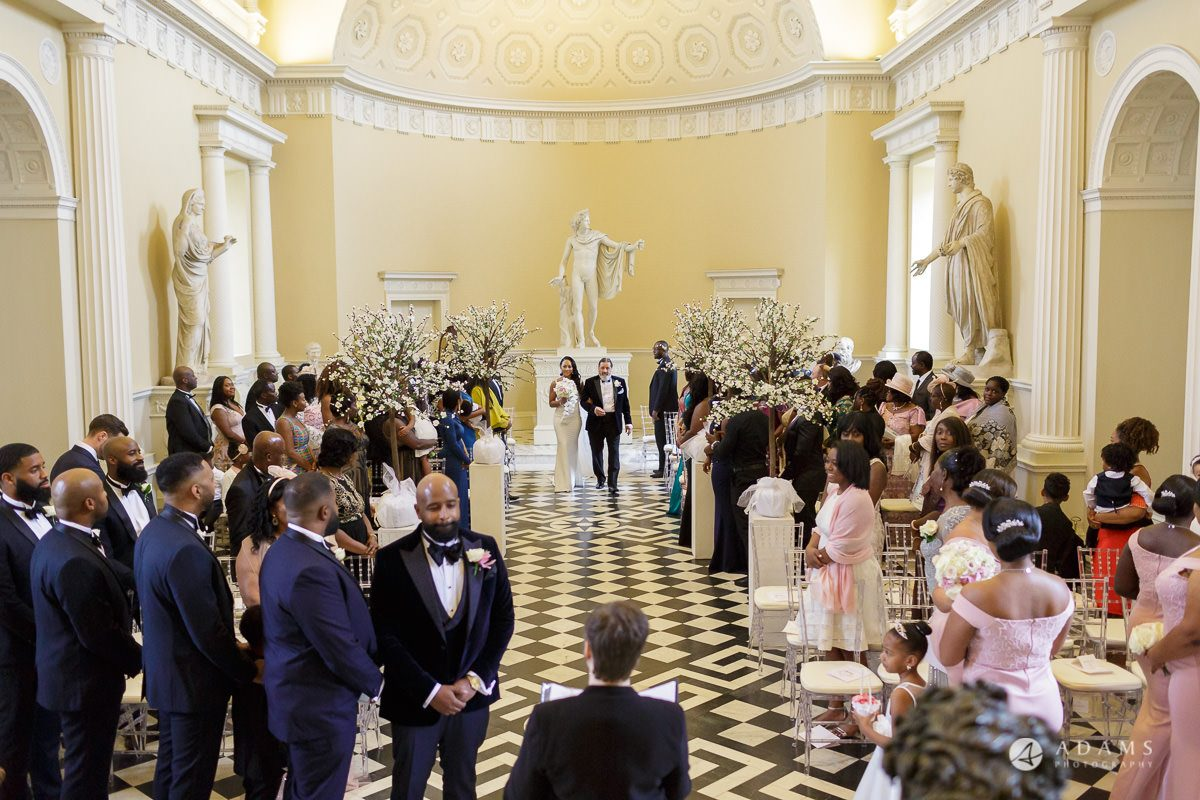 syon park house wedding bride and groom walking the aisle