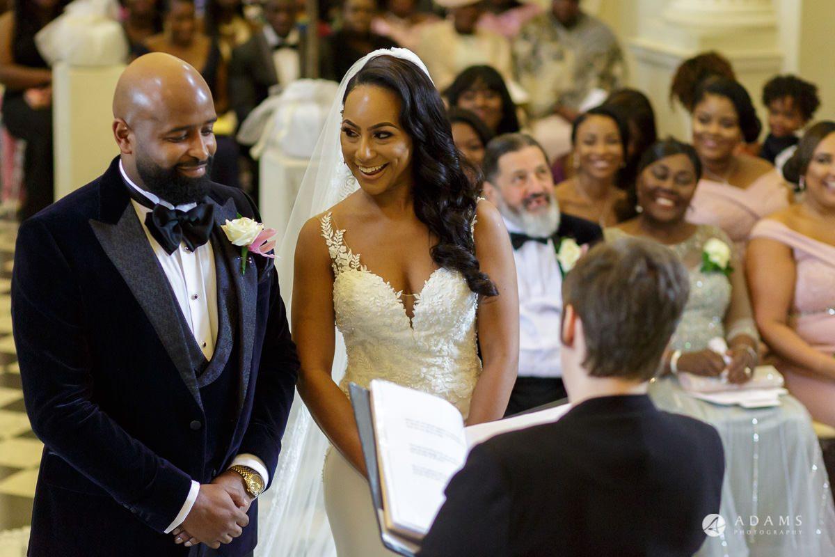 syon park house wedding bride smiles to the groom