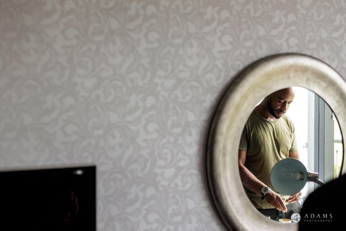 groomsman in the mirror