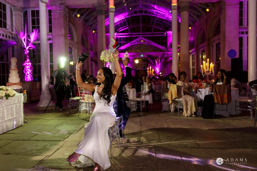syon park house wedding bride and groom having games