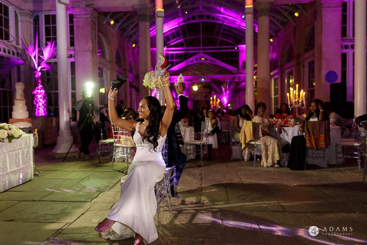 syon park house wedding bride and groom having games