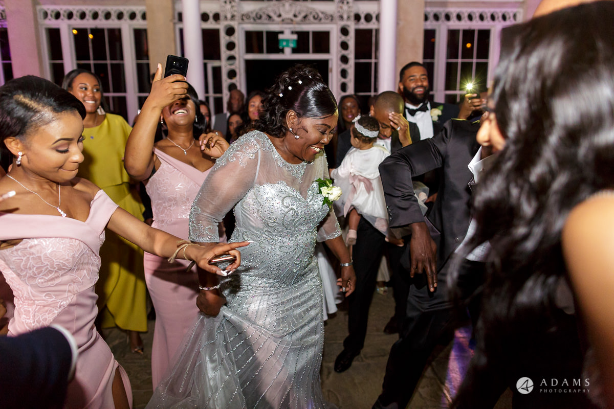 syon park house wedding guests are dancing