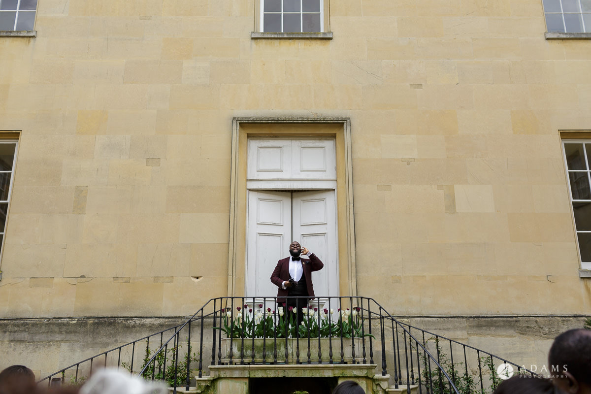 syon park house wedding groomsman is announcing the newly wed