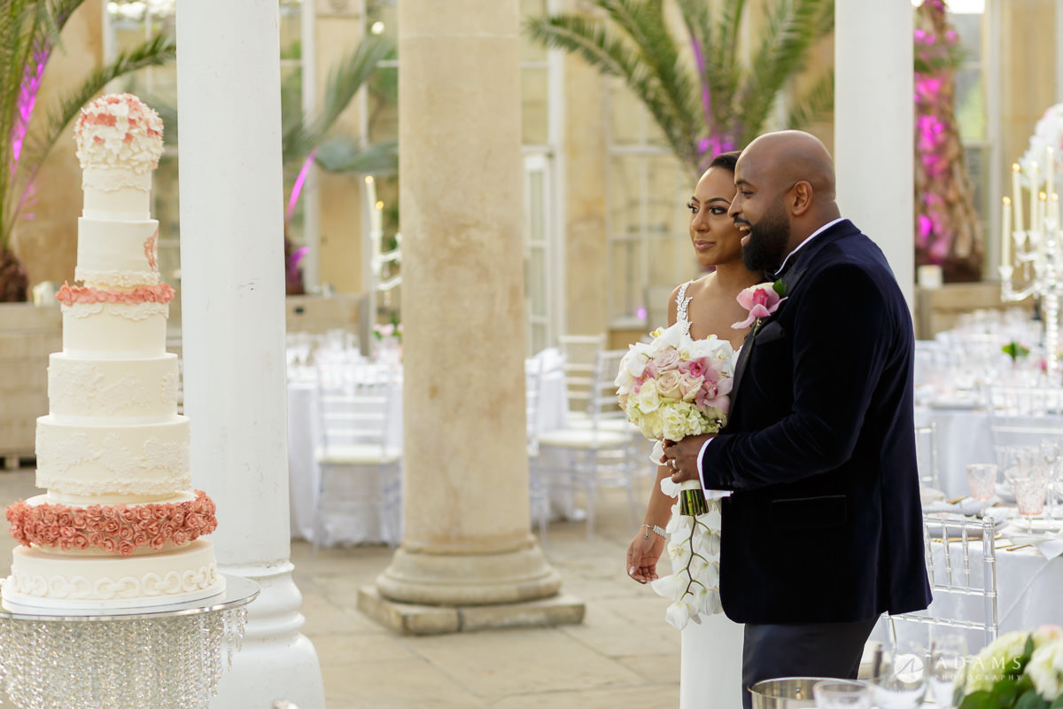 syon park house wedding couple walks in to the conservatory
