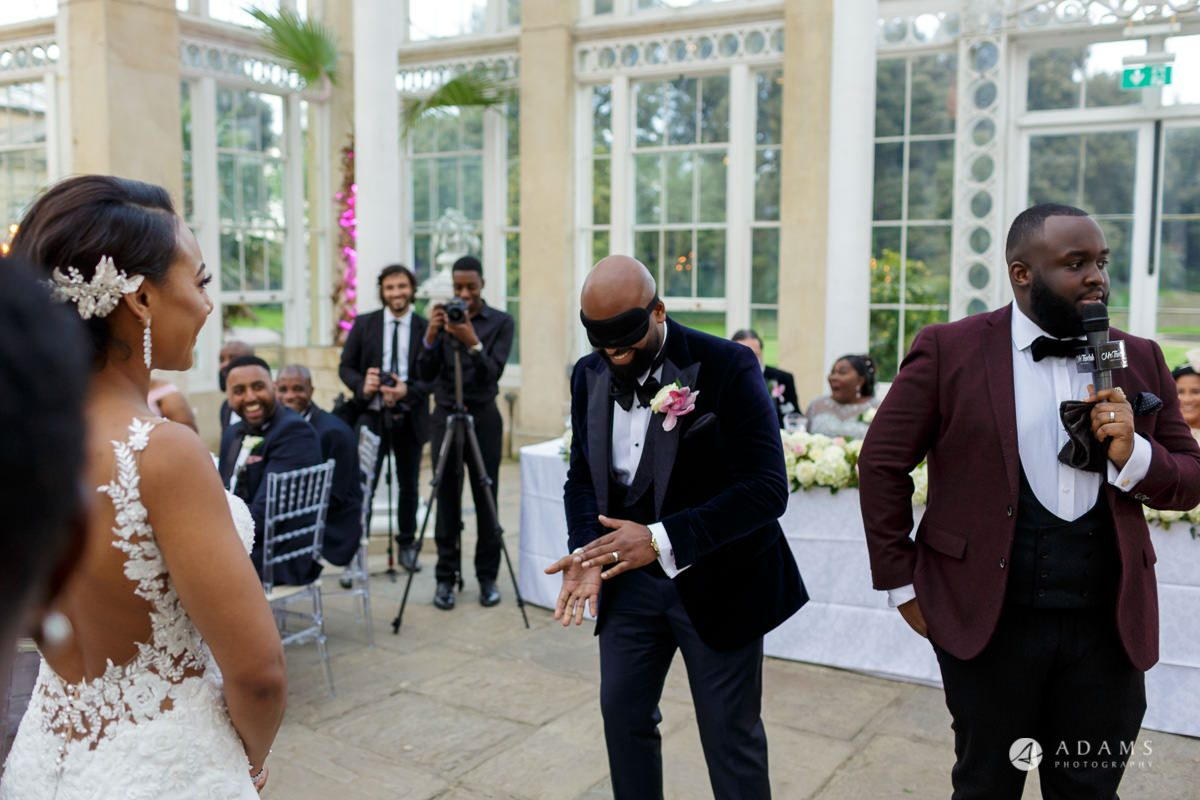 syon park house wedding groom blindfold