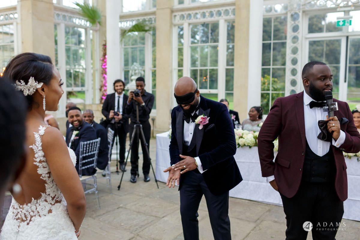 syon park house wedding groom blindfold