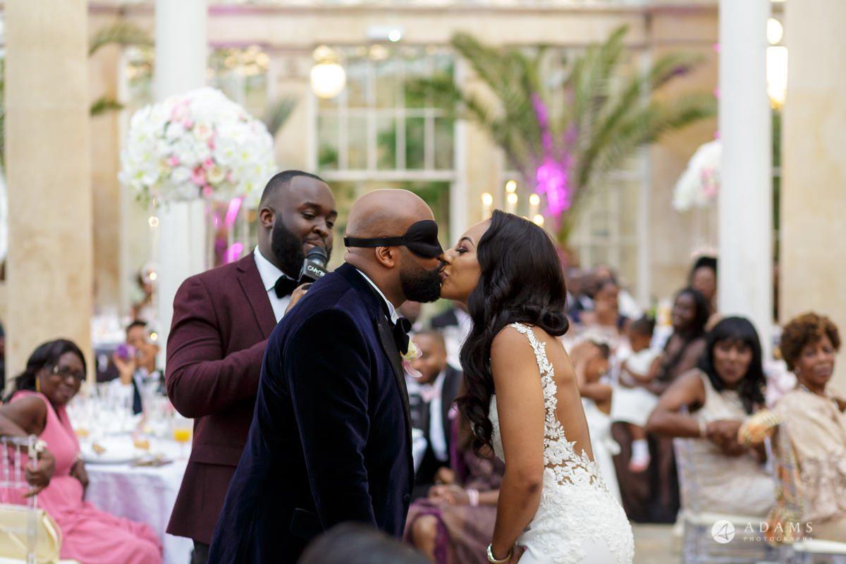 syon park house wedding groom kisses the bride