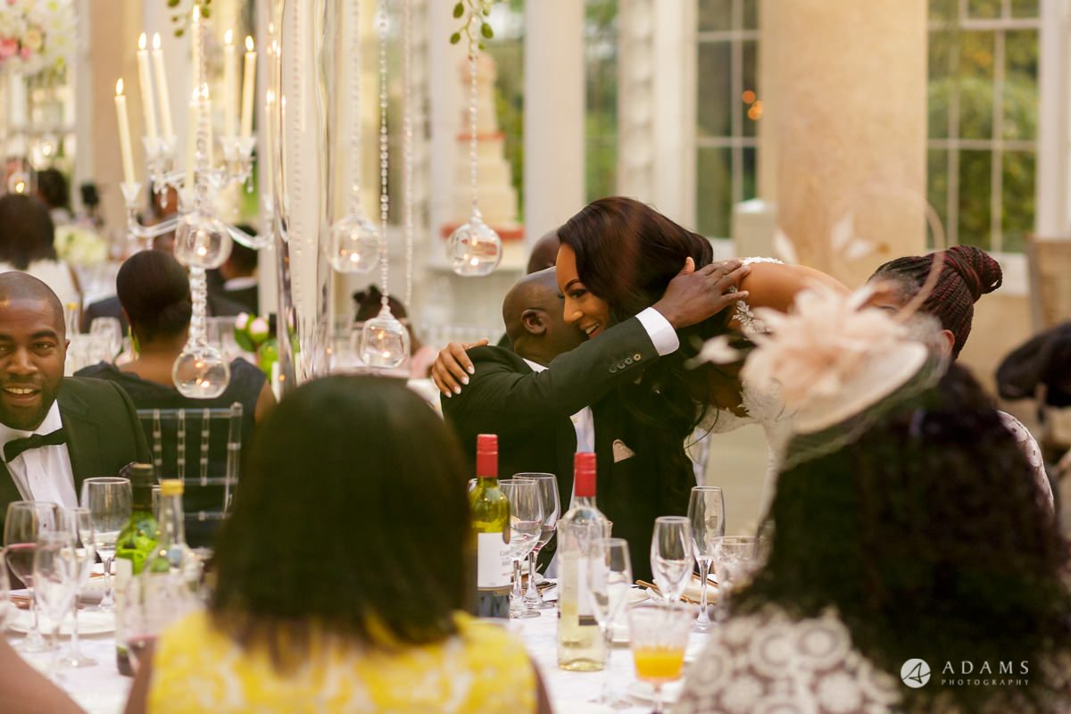 syon park house wedding guest hug each other